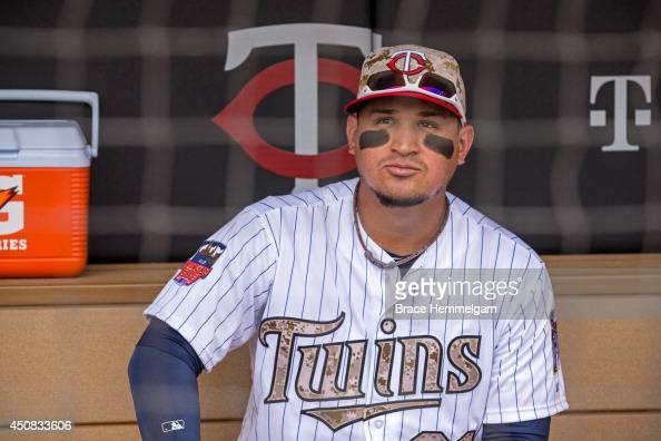 Oswaldo Arcia of the Minnesota Twins looks on against the Texas Rangers on May 26 2014 at Target Field in Minneapolis Minnesota The Rangers defeated...