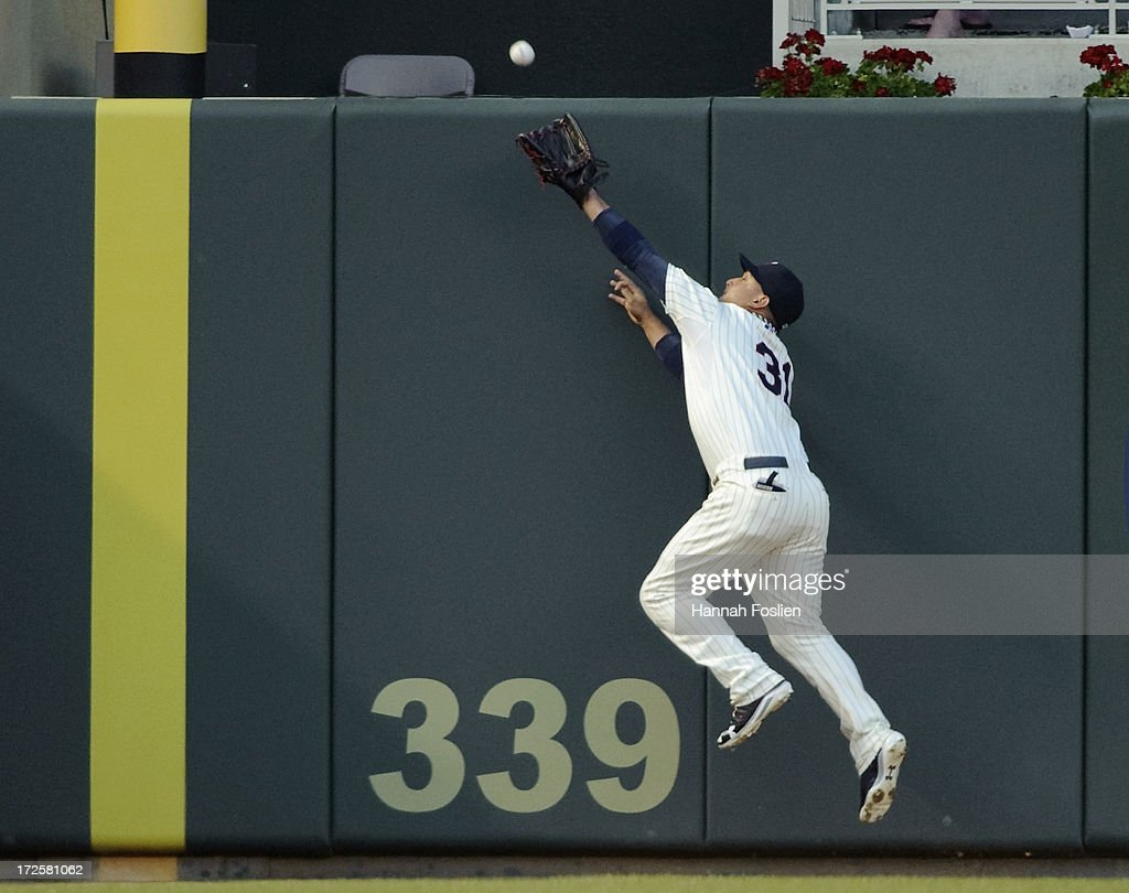 Oswaldo Arcia #31 of the Minnesota Twins makes a catch in left field of the baseball hit by Luis Cruz #61 of the New York Yankees during the fifth inning of the game on July 3, 2013 at Target Field in Minneapolis, Minnesota.