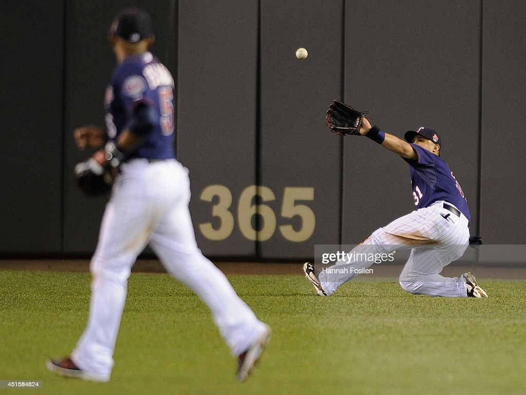 Oswaldo Arcia #31 of the Minnesota Twins makes a catch in right field on a ball off the bat of Mike Moustakas (not pictured) of the Kansas City Royals during the ninth inning of the game on July 1, 2014 at Target Field in Minneapolis, Minnesota. The Twins defeated the Royals 10-2.