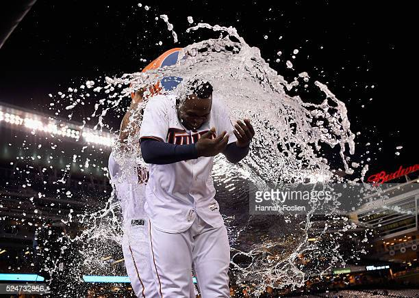 Oswaldo Arcia of the Minnesota Twins pours water on teammate Miguel Sano after Sano hit a walkoff single against the Cleveland Indians during the...