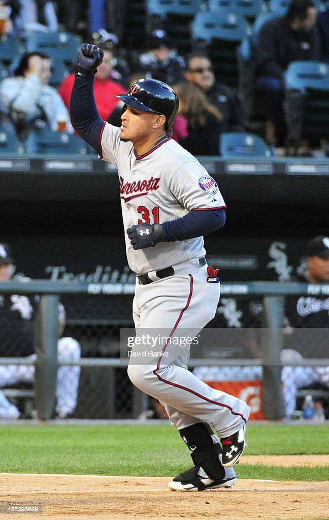 <a gi-track='captionPersonalityLinkClicked' href=/galleries/search?phrase=Oswaldo+Arcia&family=editorial&specificpeople=8948415 ng-click='$event.stopPropagation()'>Oswaldo Arcia</a> #31 of the Minnesota Twins reacts after hitting a three-run homer against the Chicago White Sox during the first inning in game two of a doubleheader on September 13, 2014 at U.S. Cellular Field in Chicago, Illinois.