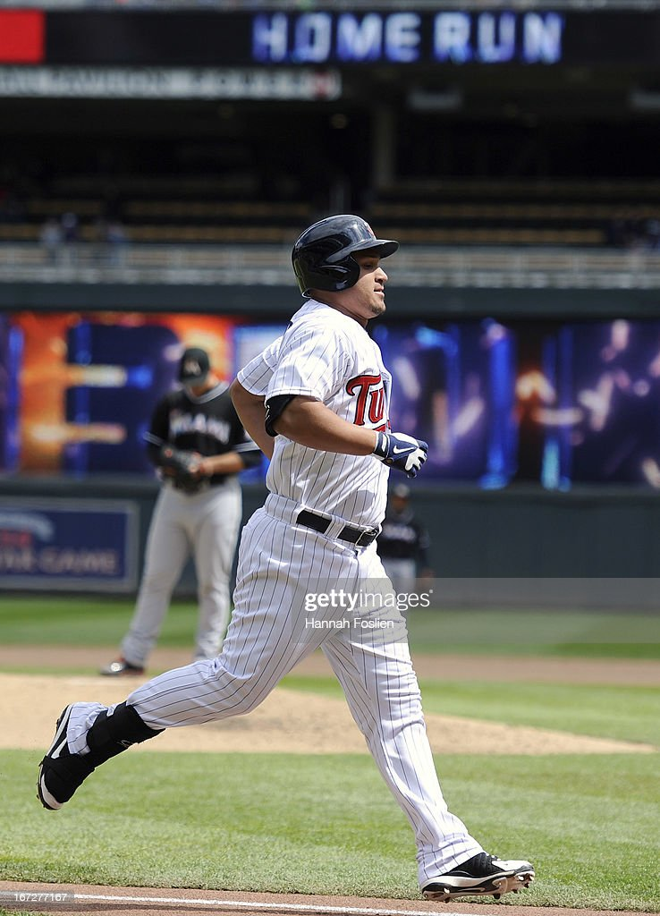 <a gi-track='captionPersonalityLinkClicked' href=/galleries/search?phrase=Oswaldo+Arcia&family=editorial&specificpeople=8948415 ng-click='$event.stopPropagation()'>Oswaldo Arcia</a> #31 of the Minnesota Twins rounds the bases after hitting a three-run home run as Jose Fernandez #16 of the Miami Marlins looks on during the fourth inning of the first game of a doubleheader on April 23, 2013 at Target Field in Minneapolis, Minnesota.