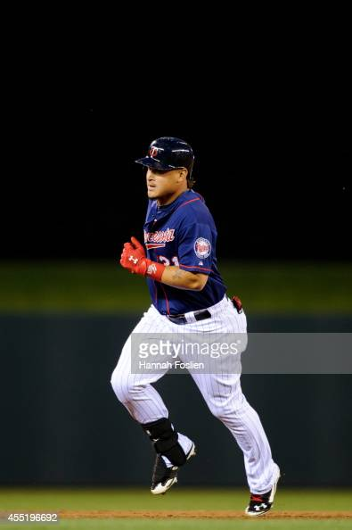 Oswaldo Arcia of the Minnesota Twins rounds the bases after hitting a home run against the Los Angeles Angels of Anaheim during the game on September...