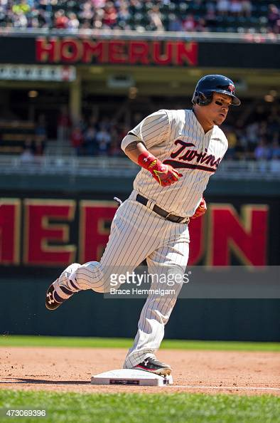 Oswaldo Arcia of the Minnesota Twins runs after hitting a home run against the Detroit Tigers on April 29 2015 at Target Field in Minneapolis...