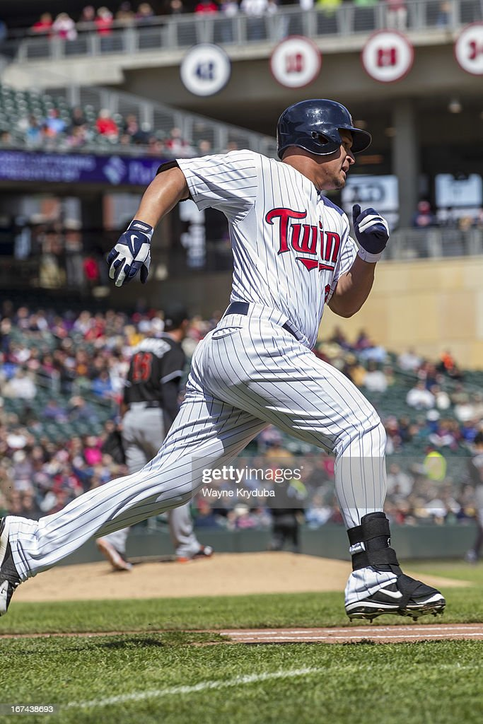 <a gi-track='captionPersonalityLinkClicked' href=/galleries/search?phrase=Oswaldo+Arcia&family=editorial&specificpeople=8948415 ng-click='$event.stopPropagation()'>Oswaldo Arcia</a> #31 of the Minnesota Twins runs to first base against the Miami Marlins on April 23, 2013 at Target Field in Minneapolis, Minnesota. The Minnesota Twins won 4-3.