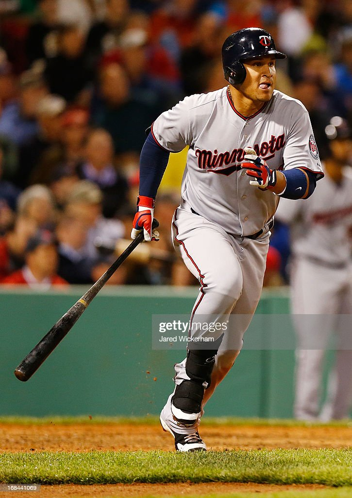 <a gi-track='captionPersonalityLinkClicked' href=/galleries/search?phrase=Oswaldo+Arcia&family=editorial&specificpeople=8948415 ng-click='$event.stopPropagation()'>Oswaldo Arcia</a> #31 of the Minnesota Twins watches the ball as he hits a two-run home run in the sixth inning against the Boston Red Sox during the game on May 9, 2013 at Fenway Park in Boston, Massachusetts.