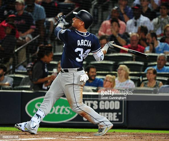 Oswaldo Arcia of the San Diego Padres hits a fourth inning tworun home run against the Atlanta Braves at Turner Field on August 30 2016 in Atlanta...
