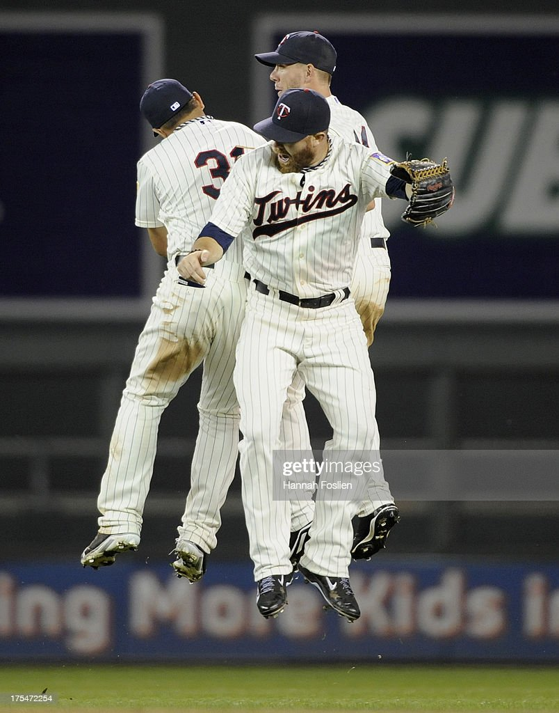 Oswaldo Arcia #31, Ryan Doumit #9 and Clete Thomas #11 of the Minnesota Twins celebrate a win of the game against the Houston Astros on August 3, 2013 at Target Field in Minneapolis, Minnesota. The Twins defeated the Astros 6-4.