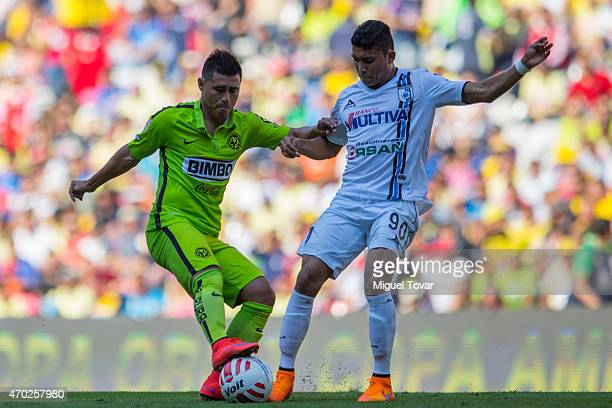 Oswaldo Martinez of America fights for the ball with Orbelin Pineda of Queretaro during a match between America and Queretaro as part of 14th round...