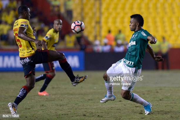 Oswaldo Minda of Barcelona fights for the ball with Miguel Borja of Palmeiras during a first leg match between Barcelona SC and Palmeiras as part of...