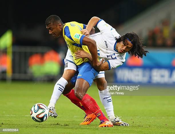 Oswaldo Minda of Ecuador battles for the ball with Roger Espinoza of Honduras during the 2014 FIFA World Cup Brazil Group E match between Honduras...