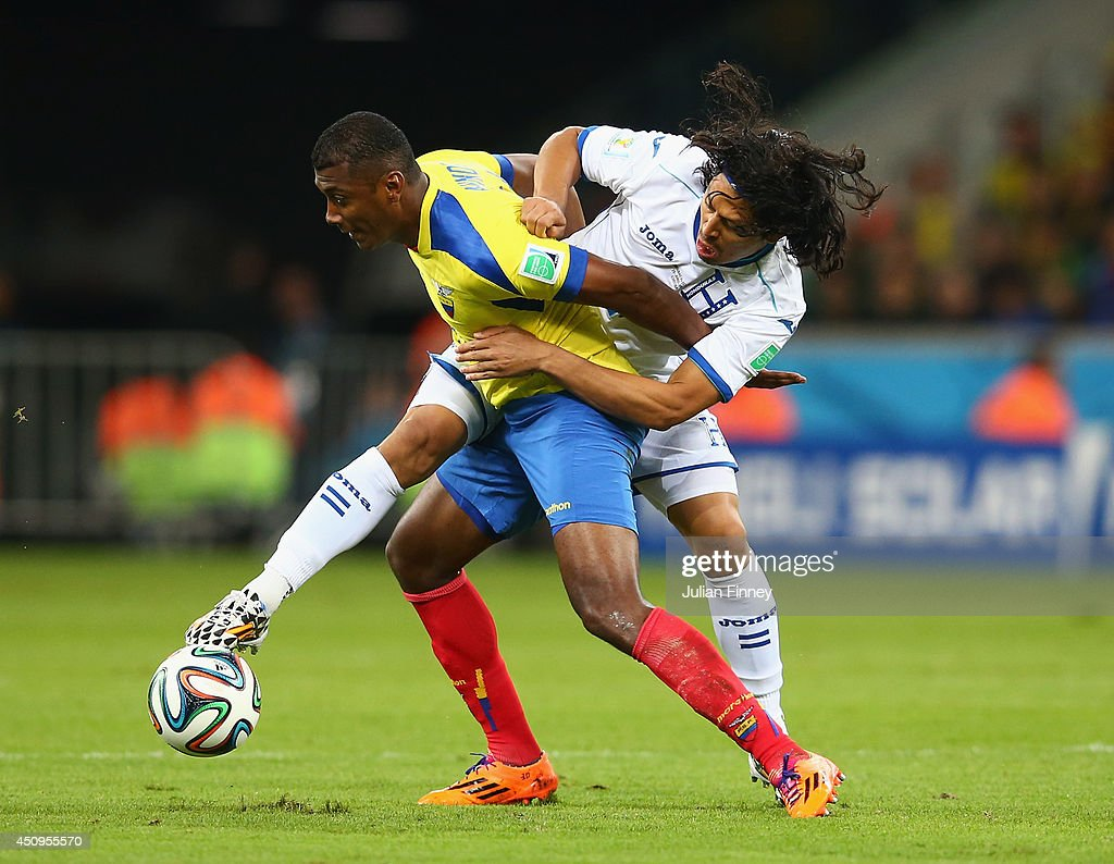Oswaldo Minda of Ecuador battles for the ball with Roger Espinoza of Honduras during the 2014 FIFA World Cup Brazil Group E match between Honduras and Ecuador at Arena da Baixada on June 20, 2014 in Curitiba, Brazil.
