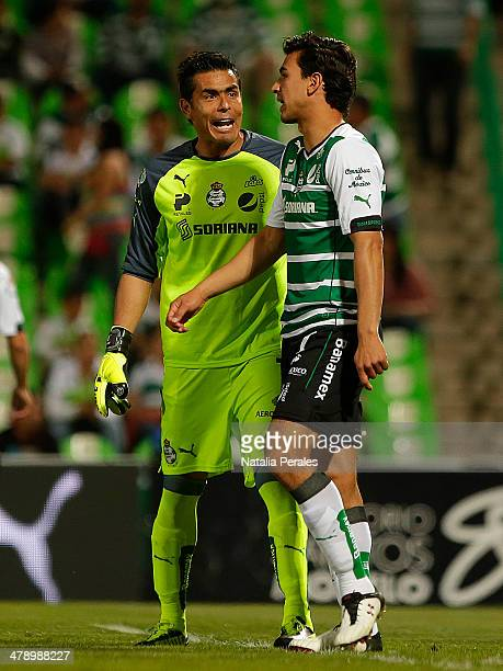 Oswaldo Sanchez and Oswaldo Alanis of Santos argue after a play during a match between Santos Laguna and Pachuca as part of the Round 11th of...