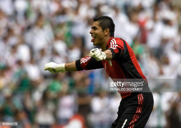 Oswaldo Sanchez goalkeeper of Mexico celebrates a goal against Jamaica during a FIFA World Cup South Africa 2010 qualifier football match at the...