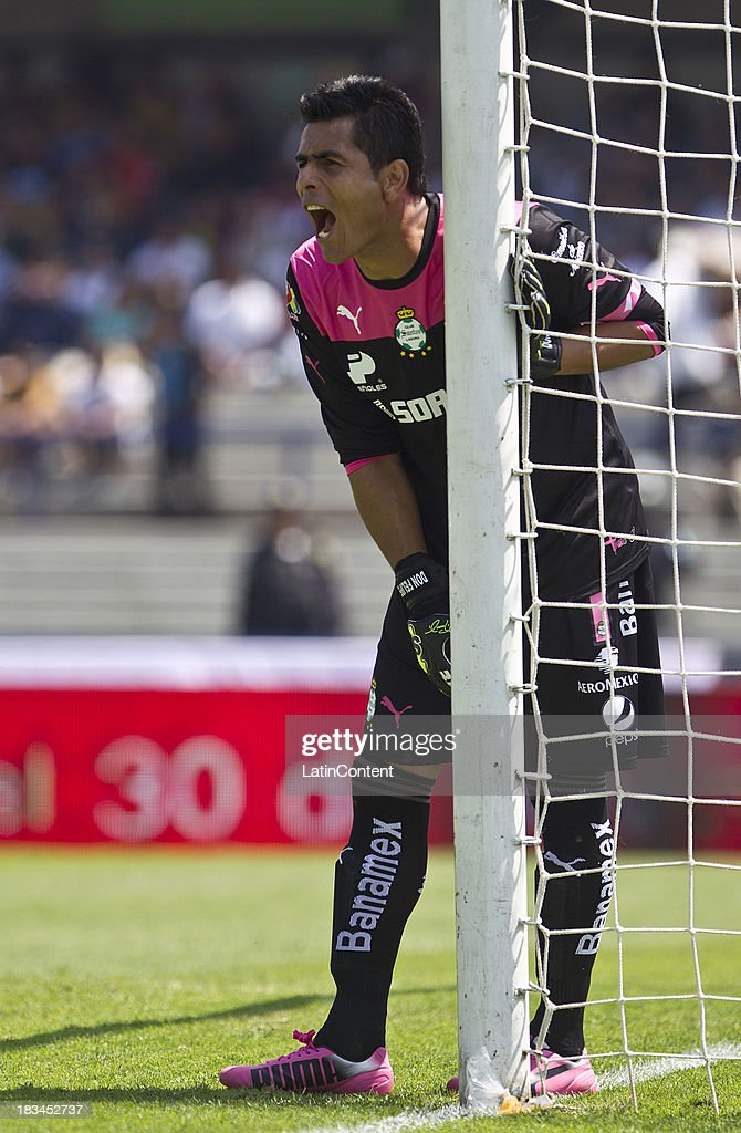 <a gi-track='captionPersonalityLinkClicked' href=/galleries/search?phrase=Oswaldo+Sanchez&family=editorial&specificpeople=213874 ng-click='$event.stopPropagation()'>Oswaldo Sanchez</a>, goalkeeper of Santos in action during a match between Pumas and Santos as part of the Apertura 2013 Liga MX at Olympic Stadium on October 06, 2013 in Mexico City, Mexico.