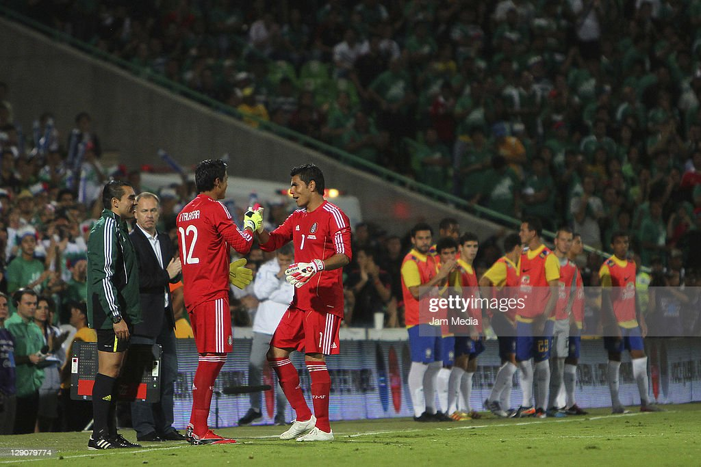 <a gi-track='captionPersonalityLinkClicked' href=/galleries/search?phrase=Oswaldo+Sanchez&family=editorial&specificpeople=213874 ng-click='$event.stopPropagation()'>Oswaldo Sanchez</a> (R) of Mexico farewell to the National Team of change leaving Alfredo Talavera (L) during a friendly match between Mexico National Team and Brasil National Team at the Georgia Dome on October 11, 2011 in Torreon, Mexico.