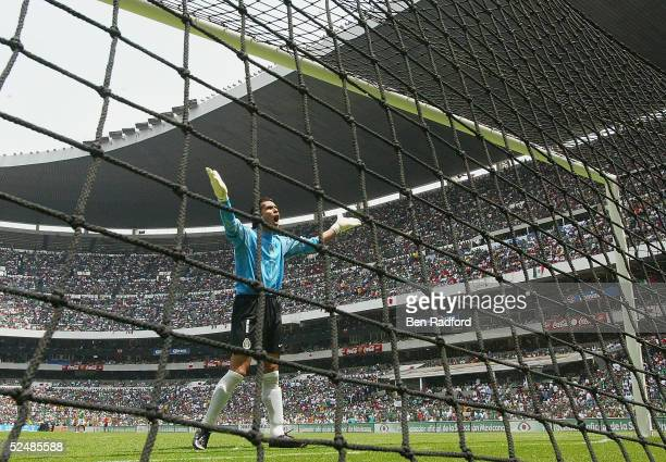 Oswaldo Sanchez of Mexico gestures to the crowd during the 2006 World Cup qualifing match between Mexico and the USA at The Azteca Stadium on March...