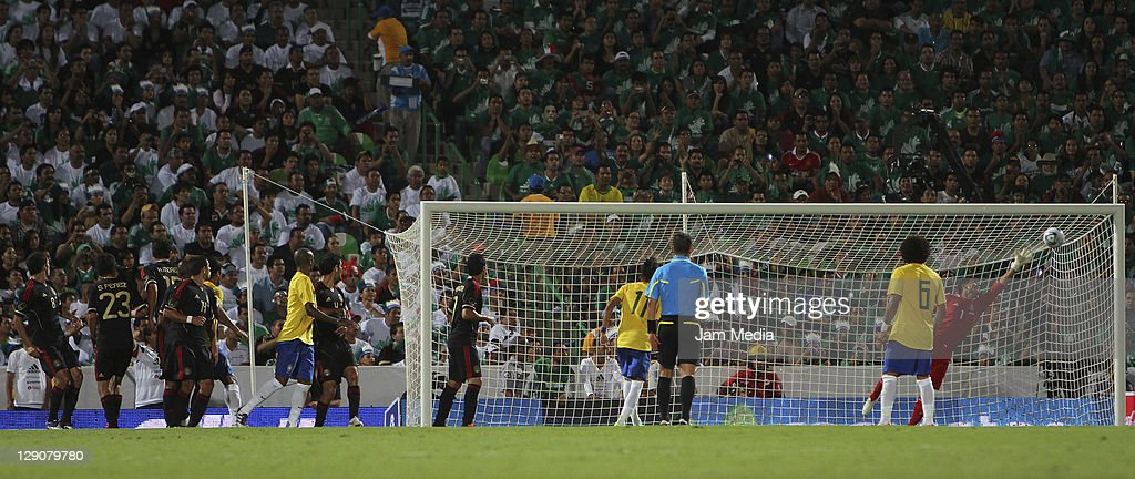 <a gi-track='captionPersonalityLinkClicked' href=/galleries/search?phrase=Oswaldo+Sanchez&family=editorial&specificpeople=213874 ng-click='$event.stopPropagation()'>Oswaldo Sanchez</a> of Mexico receives a goal during a friendly match between Mexico National Team and Brasil National Team at the Georgia Dome on October 11, 2011 in Torreon, Mexico.