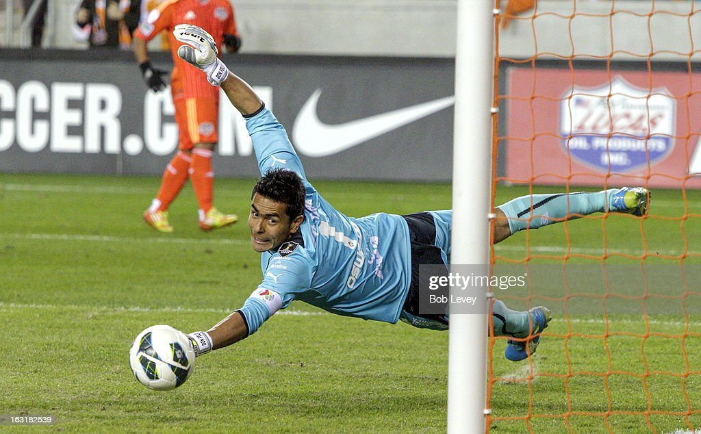 <a gi-track='captionPersonalityLinkClicked' href=/galleries/search?phrase=Oswaldo+Sanchez&family=editorial&specificpeople=213874 ng-click='$event.stopPropagation()'>Oswaldo Sanchez</a> #1 of Santos Laguna dives but cannot stop the shot from Brad Davis #11 of Houston Dynamo for a goal in the 89th minute during the second half at BBVA Compass Stadium on March 5, 2013 in Houston, Texas.