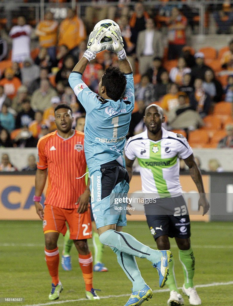 <a gi-track='captionPersonalityLinkClicked' href=/galleries/search?phrase=Oswaldo+Sanchez&family=editorial&specificpeople=213874 ng-click='$event.stopPropagation()'>Oswaldo Sanchez</a> #1 of Santos Laguna makes a save against the Houston Dynamo during the second half at BBVA Compass Stadium on March 5, 2013 in Houston, Texas.