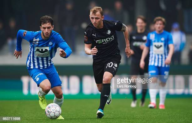 Otar Kakabadze of Esbjerg fB and Marcus Molvadgaard of Randers FC compete for the ball during the Danish Alka Superliga match between Esbjerg fB and...