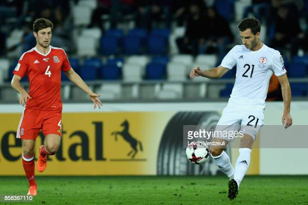Otar Kakabadze of Georgia and Ben Davies of Wales in action during the FIFA 2018 World Cup Qualifier between Georgia and Wales at Boris Paichadze...