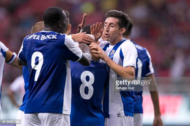 Otavio Monteiro of Porto celebrates with teammates after scoring the second goal of his team during the friendly match between Chivas and Porto at...
