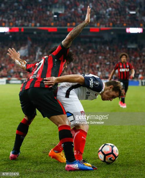 Otavio of Atletico PR and Bautista Merlini of San Lorenzo and Thiago Maia of Atletico PR in action during the match between Atletico PR of Brazil and...