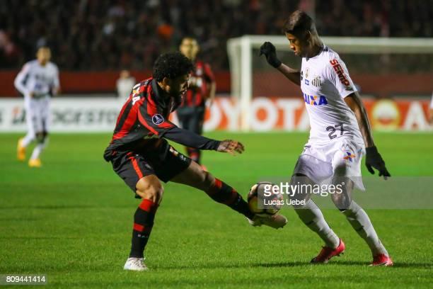 Otavio of Atletico PR battles for the ball against Bruno Henrique of Santos during the match Atletico PR v Santos as part of Copa Bridgestone...