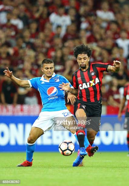Otavio of Brazil's Atletico Paranaense struggles for the ball with Jhon Duque of Colombia's Millonarios during a Libertadores Cup football match at...