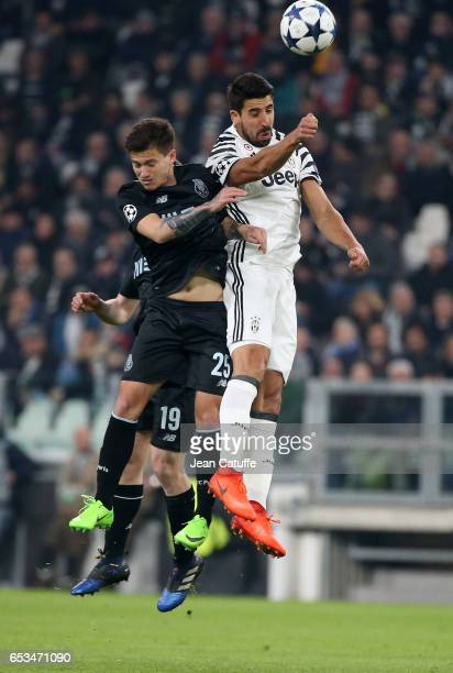 Otavio of FC Porto and Sami Khedira of Juventus in action during the UEFA Champions League Round of 16 second leg match between Juventus Turin and FC...