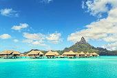 Otemanu mountain and luxury bungalow at Bora Bora island, Tahiti, French Polynesia