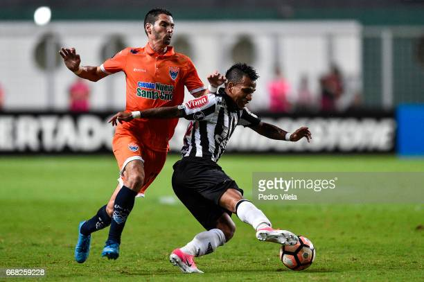Otero of Atletico MG and Ferreira of Sport Boys battle for the ball during a match between Atletico MG and Sport Boys as part of Copa Bridgestone...