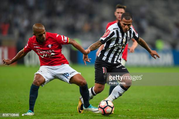 Otero of Atletico MG and Serginho of Jorge Wilstermann battle for the ball during a match between Atletico MG and Jorge Wilstermann as part of Copa...