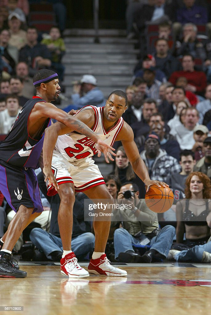 Othella Harrington #24 of the Chicago Bulls dribbles against Jalen Rose #5 of the Toronto Raptors during the game at the United Center on January 9, 2006 in Chicago, Illinois. The Bulls won 113-104.