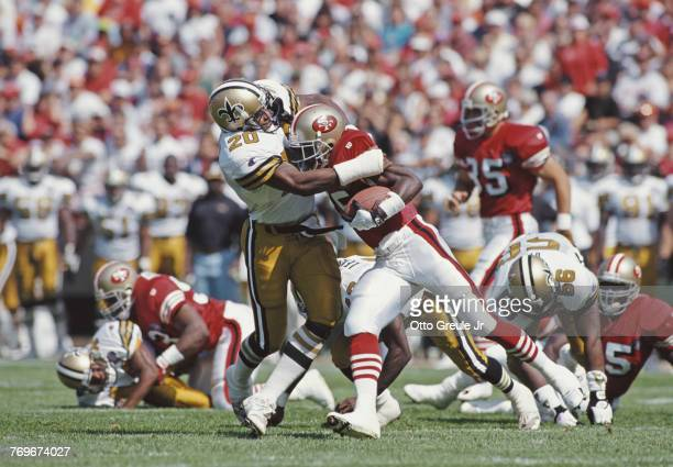 Othello Henderson Defensive Back for the New Orleans Saints tackles Dexter Carter Running Back and kick returner for the San Francisco 49ers during...