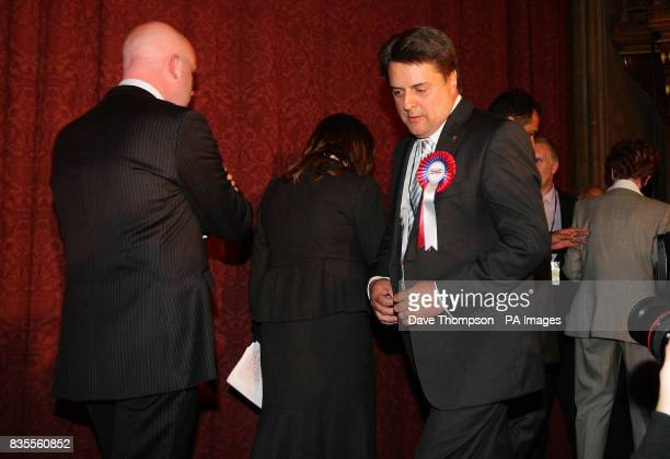 Other elected MEPs leave the stage as BNP leader Nick Griffin takes to the platform after the results of the European Parliamentary Election were...