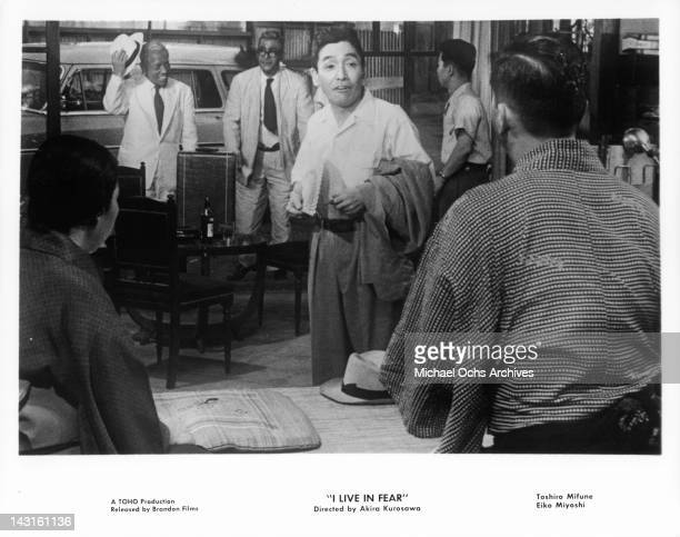 Others talking as Toshiro Mifune arrives at restaurant in a scene from the film 'I Live In Fear' 1955