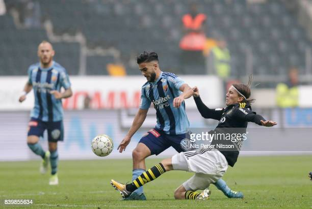 Othman El Kabir of Djurgardens IF and Kristoffer Olsson of AIK competes for the ball during the Allsvenskan match between AIK and Djurgardens IF at...