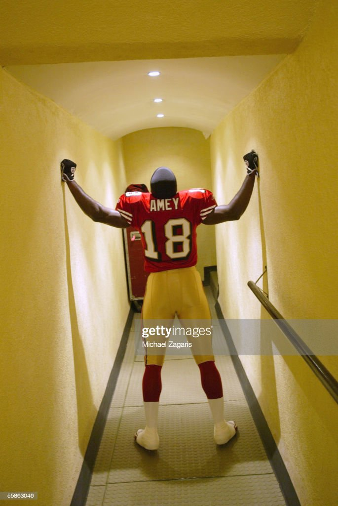Otis Amey #18 of the San Francisco 49ers leaves the locker room before the game against the Arizona Cardinals during the NFL game at Estadio Azteca on October 2, 2005 in Mexico City, Mexico.