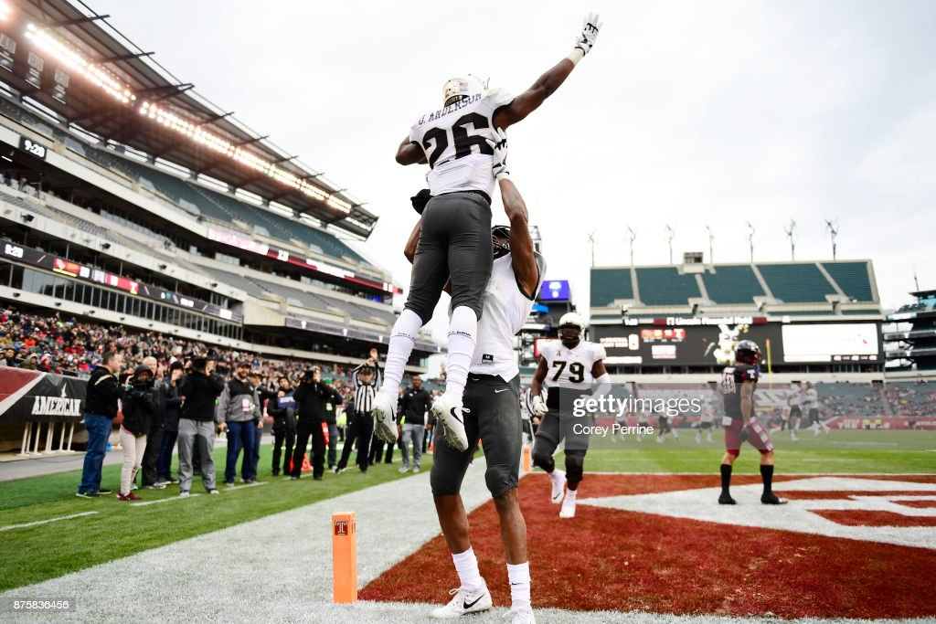Otis Anderson #26 of the UCF Knights is hoisted by teammate Tre'Quan Smith #4 after scoring a touchdown against the Temple Owls during the second quarter at Lincoln Financial Field on November 18, 2017 in Philadelphia, Pennsylvania.