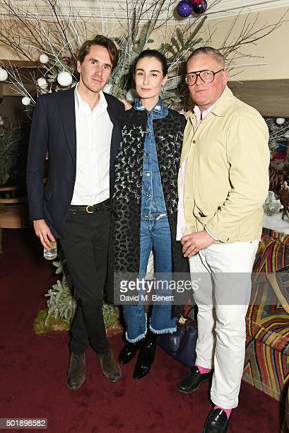 Otis Ferry Erin O'Connor and Giles Deacon attend the LOVE Christmas party at George on December 18 2015 in London England