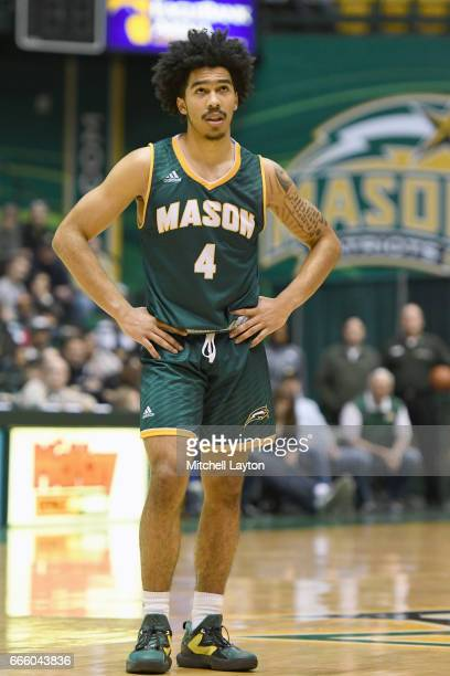 Otis Livingston II of the George Mason Patriots looks on during a college basketball game against the Rhode Island Rams at Eagle Bank Arena on...