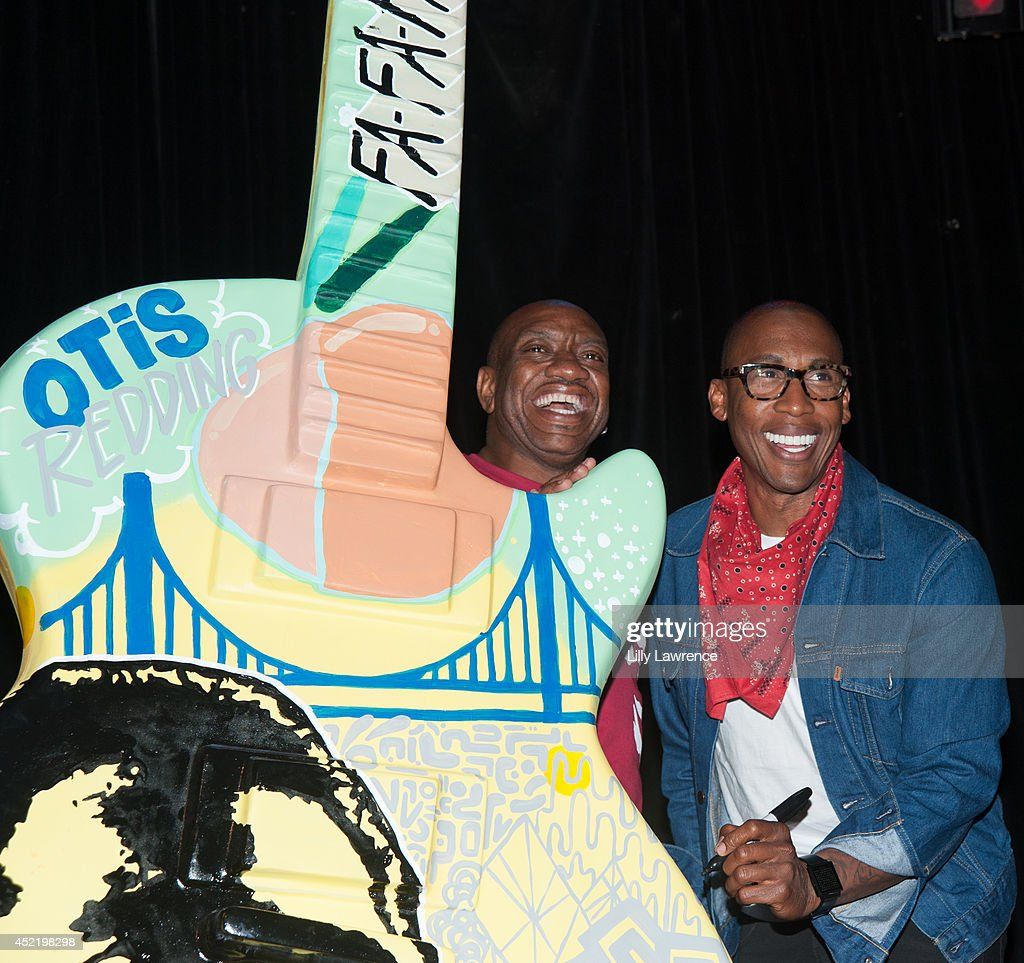 Otis Redding III and <a gi-track='captionPersonalityLinkClicked' href=/galleries/search?phrase=Raphael+Saadiq&family=editorial&specificpeople=858977 ng-click='$event.stopPropagation()'>Raphael Saadiq</a> autograph a Gibson Art Guitar honoring the late Otis Redding at The Whiskey A Go Go on July 15, 2014 in West Hollywood, California.