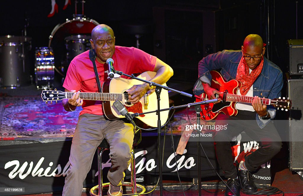 Otis Redding III and Raphael Saadiq perform during special art guitar tribute to Grammy Lifetime Achievement Award recipient and Rock and Roll Hall of Famer Otis Redding at The Whiskey A Go Go on July 15, 2014 in West Hollywood, California.