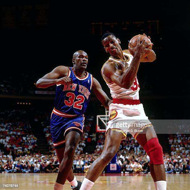 Otis Thorpe of the Houston Rockets secures the rebound against Herb Williams of the New York Knicks during Game One of the NBA Finals played on June...