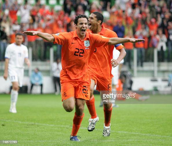 Otman Bakkal of the Netherlands celebrates scoring with team mate Hedwiges Maduro during the UEFA European Under21 Championship Final match between...