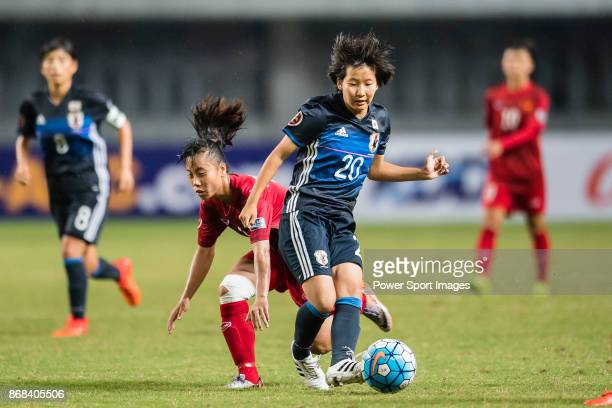 Oto Kanno of Japan in action against Truc Huong of Vietnam during their AFC U19 Women'u2019s Championship 2017 Group Stage B match between Japan and...