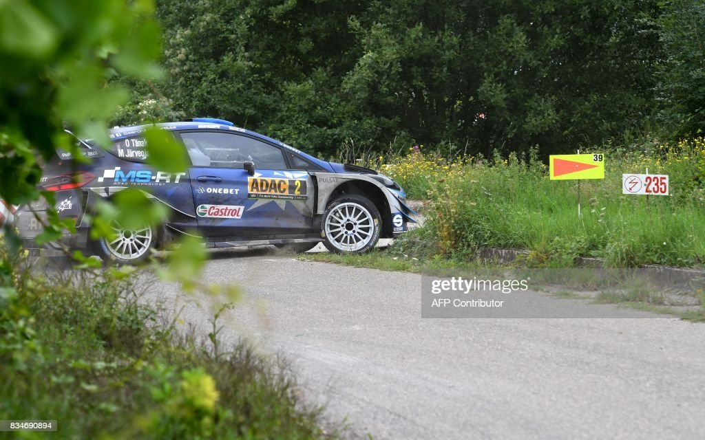 Ott Tanak of Estland and his co-driver Martin Jarveoja of Estland steer their Ford Fiesta WRC during stage 3 of the Rally Germany in Klueserath near Trier, western Germany, on August 18, 2017. /