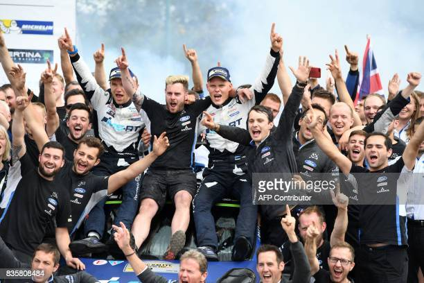 TOPSHOT Ott Tanak of Estonia and his co driver Martin Jarveoja of Estonia celebrate with their team after they finish at the first place in front of...